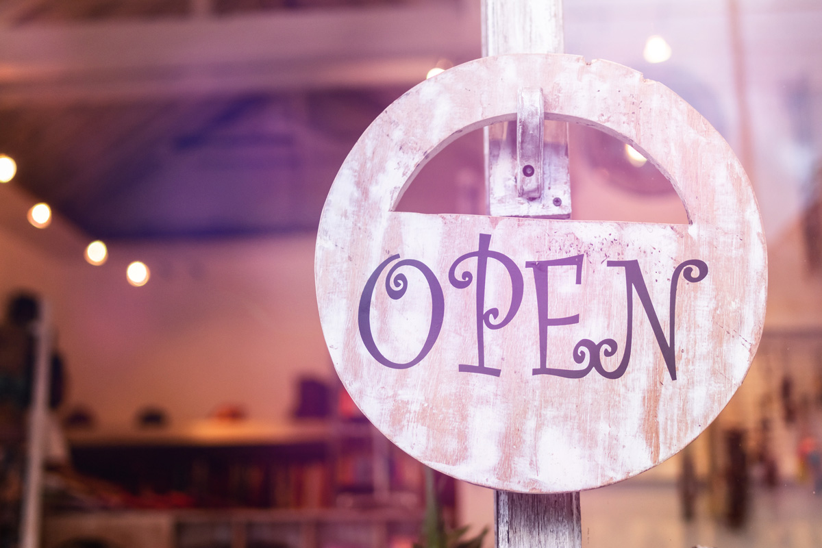 """An """"Open"""" sign in the window of a shop"""