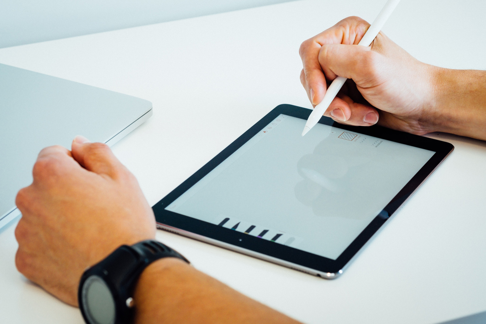 An artist drawing on a tablet