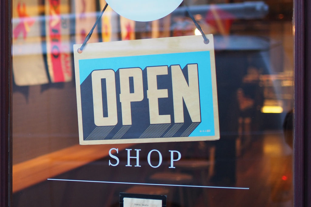 An 'Open' sign on a store window