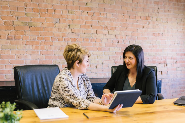 two women discussing a business plan