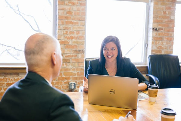 Woman interviewing a man in an office setting